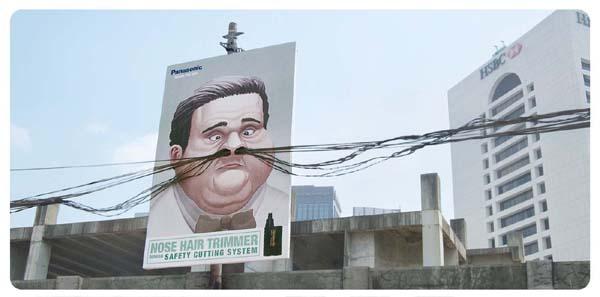 Il divertente cartellone pubblicitario di un rasoio per peli del naso (Panasonic)